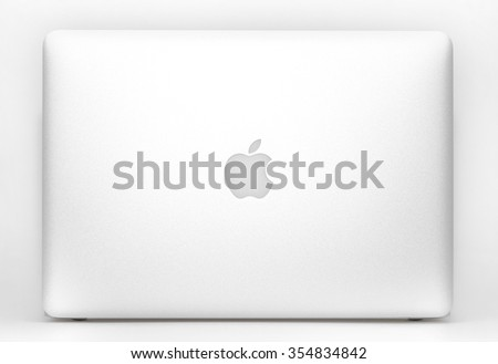 Krynica - Zdroj, POLAND - October 30 , 2015: Photo of new Macbook Air With OS X Yosemite on table in office. Macbook Air - personal computers, created by Apple Inc. - stock photo
