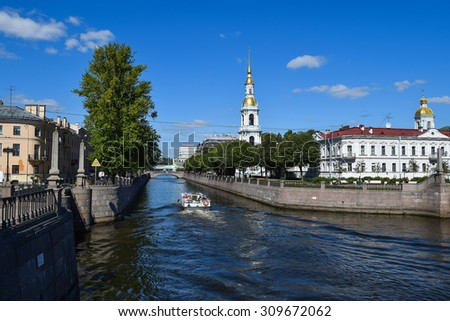 Kryukov and Griboyedov canals. View of the bell tower of St. Nicholas Cathedral in Saint-Petersburg, Russia. - stock photo