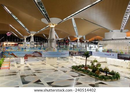 KUALA LUMPUR-APRIL 23: airport interior on April 23, 2014 in Kuala Lumpur, Malaysia. Kuala Lumpur International Airport (KLIA) is Malaysia's main international airport - stock photo