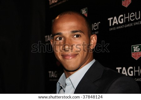 KUALA LUMPUR - APRIL 4: British F1 driver Lewis Hamilton poses for the media at the 2007 TAG Heuer F1 Street Party April 4, 2007 in Kuala Lumpur, Malaysia. - stock photo
