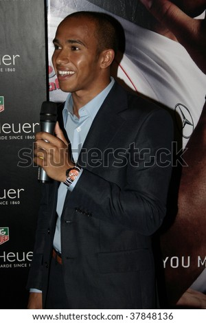 KUALA LUMPUR - APRIL 4: British F1 driver Lewis Hamilton speaks to the media at the 2007 TAG Heuer F1 Street Party April 4, 2007 in Kuala Lumpur, Malaysia. - stock photo