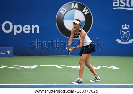 KUALA LUMPUR - APRIL 20, 2014: Chan Hao-Ching of Taiwan serves at the doubles final of the BMW Malaysian Open Tennis in Kuala Lumpur, Malaysia. She partners Timea Babos of Hungary to emerge winners.