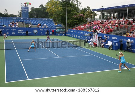 KUALA LUMPUR - APRIL 19, 2014: Chan Yung-Jan and Zheng Saisai take on Olga Savchuk and Lyudmyla Kichenok in the women's semifinals of the BMW Malaysian Open tennis is Kuala Lumpur, Malaysia. - stock photo