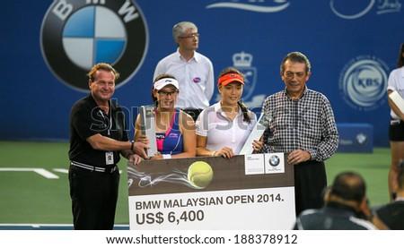 KUALA LUMPUR - APRIL 20, 2014:Chan Yung-Jan (white) of Taiwan and Zheng Saisai of China (blue-red) emerge runners-up in the Doubles of the BMW Malaysian Open Tennis in Kuala Lumpur, Malaysia. - stock photo