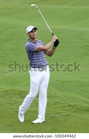 KUALA LUMPUR - APRIL 15: Charl Schwartzel of South Africa hits shot in the 18th hole during final day of Maybank Malaysian Open 2012 at Kuala Lumpur Golf & Country Club on April 15, 2012