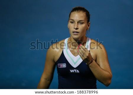 KUALA LUMPUR - APRIL 20, 2014: Dominika Cibulkova of Slovakia reacts in the Singles final of the BMW Malaysian Open Tennis in Kuala Lumpur, Malaysia. She lost to Donna Vekic of Croatia. - stock photo