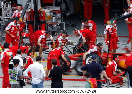 kuala lumpur april 2 ferrari pitcrew stock photo 67672960 shutterstock. Black Bedroom Furniture Sets. Home Design Ideas