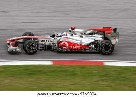 KUALA LUMPUR - APRIL 4: McLaren Mercedes driver Jenson Button takes the hairpin turn on race day at the 2010 Petronas Malaysia Grand-Prix on April 4, 2010 in Sepang International Circuit, Malaysia.
