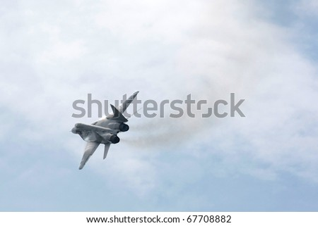 KUALA LUMPUR - APRIL 4: Royal Malaysian Air Force MIG-29N fighter jet performs aerial acrobatics stunts on race day at the 2010 Petronas Malaysia F1 Grand-Prix on April 4, 2010 in Sepang, Malaysia.
