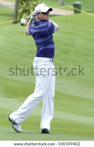 KUALA LUMPUR - APRIL 15: Simon Dyson of England hits shot on the 10th holes during final round of Maybank Malaysian Open 2012 at Kuala Lumpur Golf & Country Club on April 15, 2012