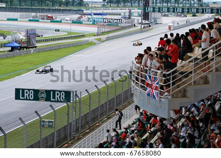 KUALA LUMPUR - APRIL 4: Spectators view the race from the gallery on race day at the 2010 Petronas Malaysia Grand-Prix on April 4, 2010 in Sepang International Circuit, Malaysia. - stock photo