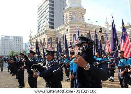 KUALA LUMPUR - Aug 28 : Bagpiper from Royal Malaysian Police Brass Band (PDRM) blowing their bagpipes during rehearsal for National Day parade on Aug 28,2015 at Dataran Merdeka, Kuala Lumpur,Malaysia