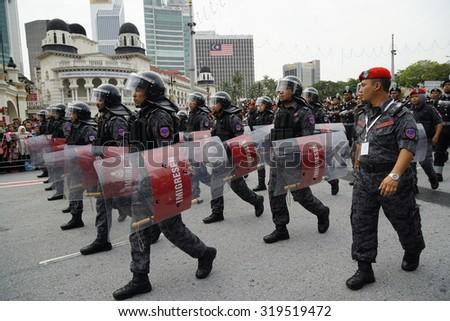 KUALA LUMPURâ AUG 31:Federal Reserve Unit from Royal Malaysia Police (Polis Diraja Malaysia/PDRM) march during the Merdeka Daya celebration on August 31,2014 in Dataran Merdeka,Kuala Lumpur,Malaysia - stock photo