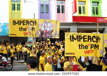 KUALA LUMPUR -  Aug 29 : Protestor showing placard critical toward the Prime Minister during Bersih 4.0 protest which demand fair and clean election in Dataran Merdeka, Kuala Lumpur, Malaysia.  - stock photo