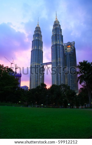 KUALA LUMPUR - AUG 27: The Petronas Twin Towers on August 27, 2010, in Kuala Lumpur, Malaysia were the world's tallest buildings from 1998 to 2004, when their height was surpassed by Taipei 101. - stock photo