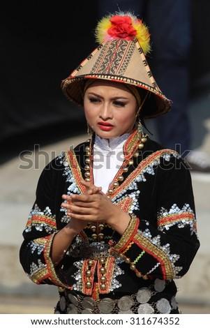 KUALA LUMPUR - Aug 29 : Unidentified young woman with tribe costume during the rehearsal for National Day parade on Aug 29,2015 at Bangunan Sultan Abdul Samad ,Dataran Merdeka, Kuala Lumpur, Malaysia - stock photo