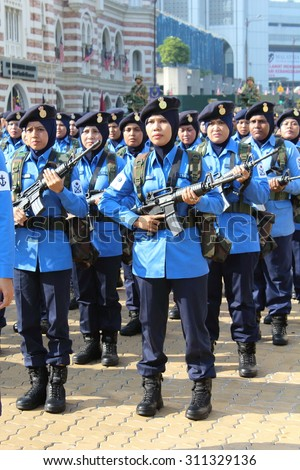 KUALA LUMPUR - Aug 28 : Woman soldier from Royal Malaysian Navy (TLDM) of Royal Malaysian Armed Forces during rehearsal for National Day parade on Aug 28,2015 at Dataran Merdeka, Kuala Lumpur,Malaysia - stock photo