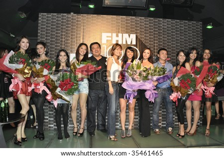 KUALA LUMPUR - AUGUST 14: Group photo of celebrities and VVIP pose for photographers at FHM 100 Most Wanted Women in The World 2009 Party at Upstairs, The Loft August 15, 2009 in Kuala Lumpur. - stock photo