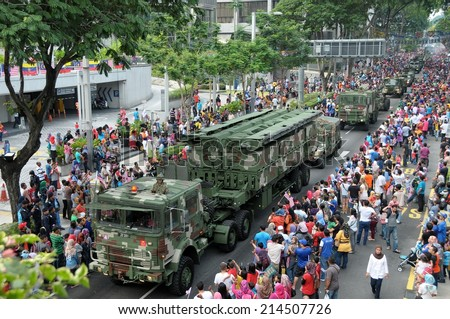 KUALA LUMPUR - AUGUST 31: Military Vehicle in full crowd during 57th Celebrations, Malaysian Independence Day Parade on August 31, 2014 in Kuala Lumpur, Malaysia.