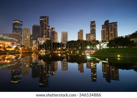 Kuala Lumpur city downtown at before sunrise with reflection of skyline, Kuala Lumpur, Malaysia - stock photo