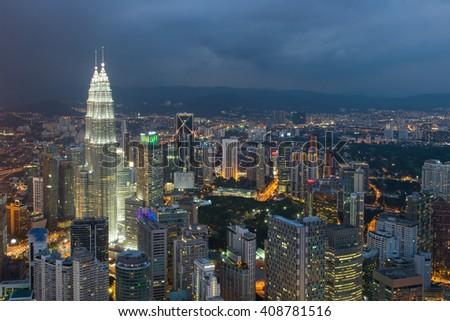 Kuala Lumpur city skyline at dusk in Malaysia  - stock photo