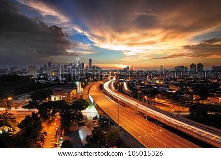 Kuala Lumpur City skyline at sunset - stock photo