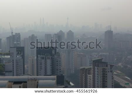 Kuala Lumpur cityscape in a hazy day - stock photo