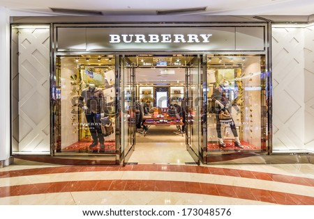 KUALA LUMPUR - DEC 23: Exterior of Burberry shop at KLCC on Dec 23, 13 in KL, Malaysia.  It is a British luxury fashion house, distributing clothing, fashion accessories, fragrances and cosmetics. - stock photo