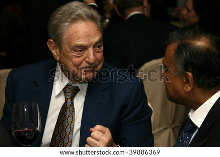 KUALA LUMPUR - DECEMBER 15: George Soros talking to former Malaysian Finance Minister Nor Mohamed Yakcop at the London School of Economics Alumni Dinner December 15, 2006 in Kuala Lumpur, Malaysia. - stock photo