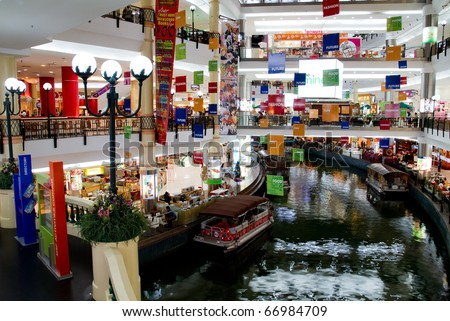 KUALA LUMPUR - DECEMBER 10: Interior of The Mines Shopping Fair on December 10, 2010 in Kuala Lumpur, Malaysia. This shopping mall  have a canal  runs right into the complex - stock photo