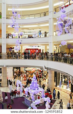 KUALA LUMPUR - DECEMBER 20: New Year interior of Suria KLCC on December 20, 2010 in Kuala Lumpur, Malaysia. Suria KLCC is the ultimate luxury shopping destination in Malaysia. - stock photo