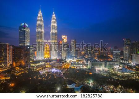 KUALA LUMPUR - FEB 12: The Petronas Twin Towers on February 12, 2014, in Kuala Lumpur, Malaysia are the world's tallest twin tower. The skyscraper height is 451.9m - stock photo