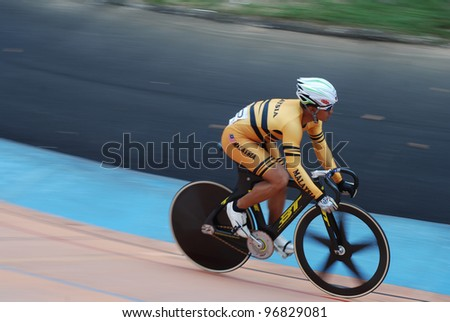 KUALA LUMPUR-FEBRUARY 12: Azizulhasni Awang from Malaysia finish second place in Keirin event during the Asian Cycling Championships 2012 at the Kuala Lumpur Velodrome, Malaysia on February 12, 2012 - stock photo