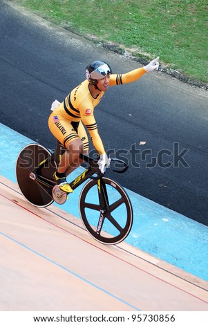 KUALA LUMPUR, FEBRUARY 12: Josiah Ng from Malaysia won first places in the Keirin event during the Asian Cycling Championships 2012 at the Kuala Lumpur Velodrome, Malaysia on February 12, 2012 - stock photo
