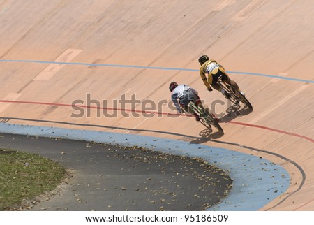 KUALA LUMPUR - FEBRUARY 9: Rider from Malaysia (right) competed with rider from Japan (left) during Asian Cycling Championships 2012 held in Kuala Lumpur, Malaysia on February 9, 2012. - stock photo