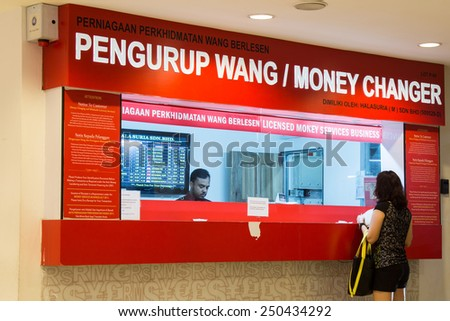 KUALA LUMPUR - February 6, 2015: World oil price slump has caused the Malaysian Ringgit depreciated further against the US Dollar, and major world currency. The Ringgit is traded at 3.56 per US$1.00 - stock photo