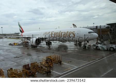 KUALA LUMPUR INTERNATIONAL AIRPORT - DECEMBER 17, 2014: Ground crew prepares Emirates Airlines plane for the next flight, December 17, 2014 in KLIA, Malaysia. - stock photo