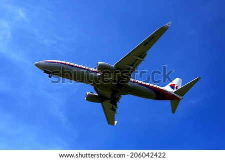 KUALA LUMPUR INTERNATIONAL AIRPORT - July 19 : Boeing 737-8FZ (9M-FFF) Malaysia Airlines ready to land at Kuala Lumpur International Airport, Malaysia on July 19, 2014.                                - stock photo