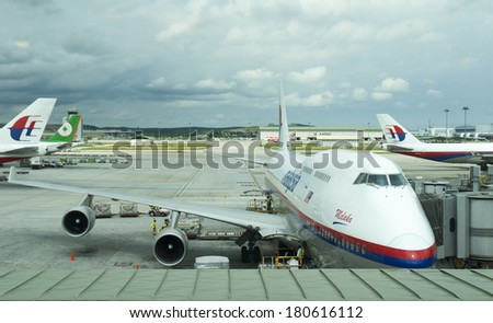 KUALA LUMPUR INTERNATIONAL AIRPORT - JUNE 23: Malaysia Airlines planes prepare for passengers to board, as ground crew prepares the plane for the flight on June 23, 2006 in KLIA, Sepang, Malaysia. - stock photo