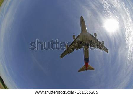 KUALA LUMPUR INTERNATIONAL AIRPORT (KLIA), SEPANG, MALAYSIA - APRIL 25: Fish eye view of Malaysia Airlines plane Boeing 747-400 lands at KLIA airport on April 25, 2006 in KLIA, Sepang, Malaysia. - stock photo