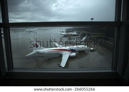 KUALA LUMPUR INTERNATIONAL AIRPORT (KLIA), SEPANG, MALAYSIA - AUGUST 08 :Malaysia Airlines plane on a wet tarmac at Kuala Lumpur International Airport (KLIA) in Sepang, Malaysia. - stock photo