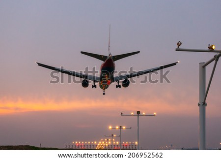KUALA LUMPUR INTERNATIONAL AIRPORT (KLIA), SEPANG, MALAYSIA - JULY 24: Malaysia Airlines plane prepares for landing during sunset at KLIA airport on July 24, 2014 in KLIA, Sepang, Malaysia.