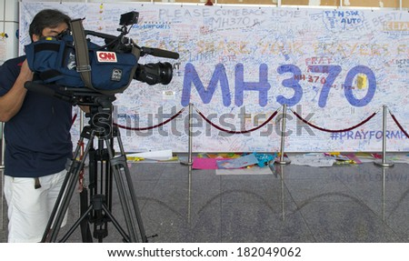 KUALA LUMPUR INTERNATIONAL AIRPORT - MARCH 17: International media CNN do a coverage on the lost Malaysia Airlines Boeing 777-200ER MH370 on March 17, 2014 in KLIA, Sepang, Malaysia. - stock photo