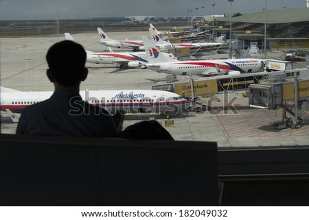 KUALA LUMPUR INTERNATIONAL AIRPORT - MARCH 17: Malaysia Airlines planes prepare for passengers to board, as ground crew prepares the plane for the flight on March 17, 2014 in KLIA, Sepang, Malaysia. - stock photo