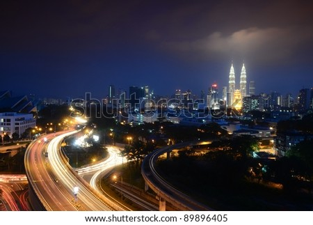 Kuala Lumpur is the capital and the largest city of Malaysia. Stunning light trail at highway in Kuala Lumpur city - stock photo