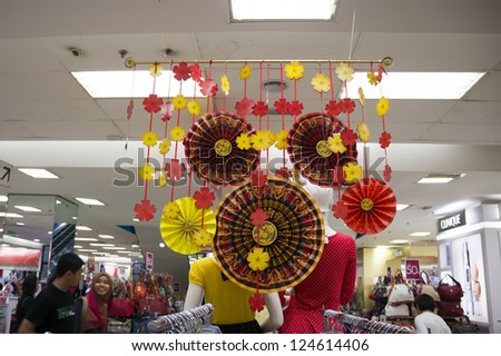 KUALA LUMPUR - JAN 14: A supermarket decorated with Chinese style in conjunction with the Chinese New Year celebrations will be held on February 10, 2013 in Kuala Lumpur, Malaysia on 14 January 2013. - stock photo