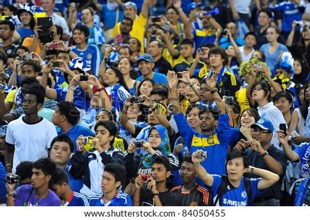 KUALA LUMPUR, JULY 21 : Chelsea fans during a preseason match against Malaysia on July 21, 2011 in Kuala Lumpur, Malaysia. Chelsea won 1-0 - stock photo