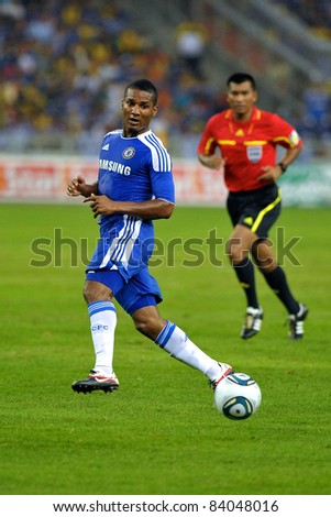 KUALA LUMPUR, July 21 : Chelsea's Florent Malouda in action during a preseason match agains Malaysia on July 21, 2011 in Kuala Lumpur, Malaysia. Chelsea won 1-0 - stock photo