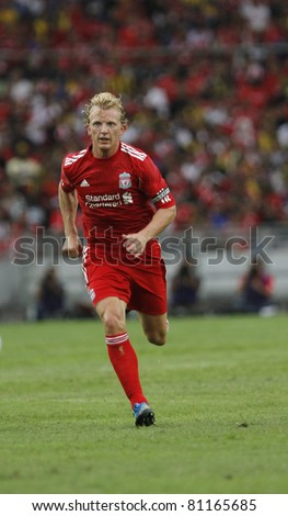 KUALA LUMPUR - JULY 16 : Liverpool football club Captain Dirk Kuyt at a friendly match against Malaysia XI on July 16, 2011 in Kuala Lumpur, Malaysia. Liverpool won 6-3. - stock photo