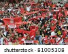 KUALA LUMPUR - JULY 14 : Liverpool football club fans cheer their players during warm up session on July 14, 2011 in Kuala Lumpur, Malaysia. Liverpool FC will meet Malaysian XI soccer team on July 16. - stock photo